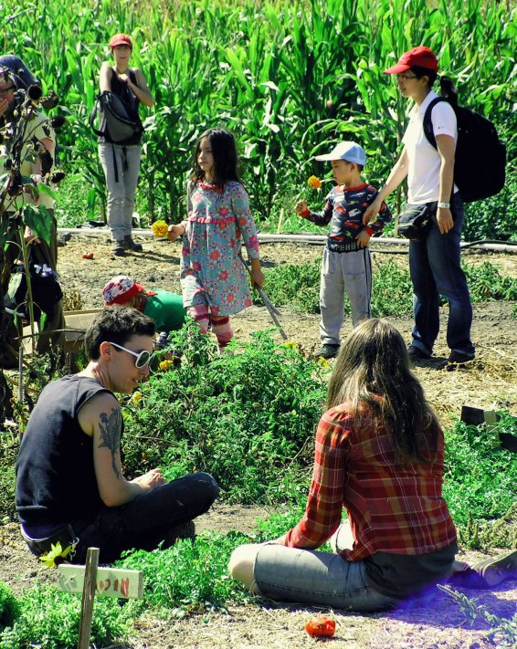Gardening at an occupied farm in the East Bay, 2013. (photo by Samara Hayley Steele)