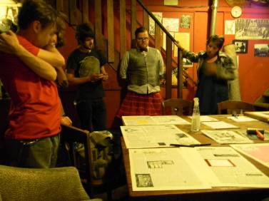 Members of the Slingshot Collective reviewing each page in a consensus meeting hours before going to print,c. 2013. (photo by Steele)