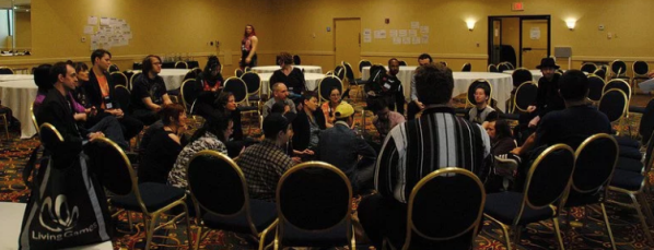 """A panel entitled """"Take the Streets: Guerilla Larp and Political Play"""" co-hosted by Steele, Albert Kong, Randy Lubin, and Joyce Clanon at the 2018 Living Games Conference."""